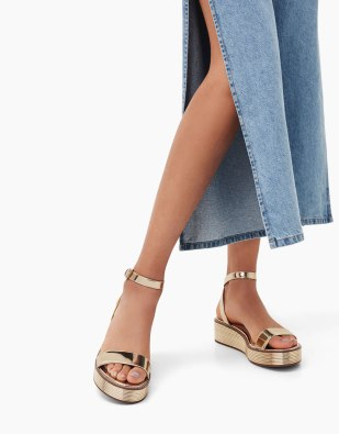 https://www.bershka.com/ie/woman/promo/promo-view-all/metallic-wedge-sandals-with-ankle-strap-c1010240163p101163007.html?colorId=091